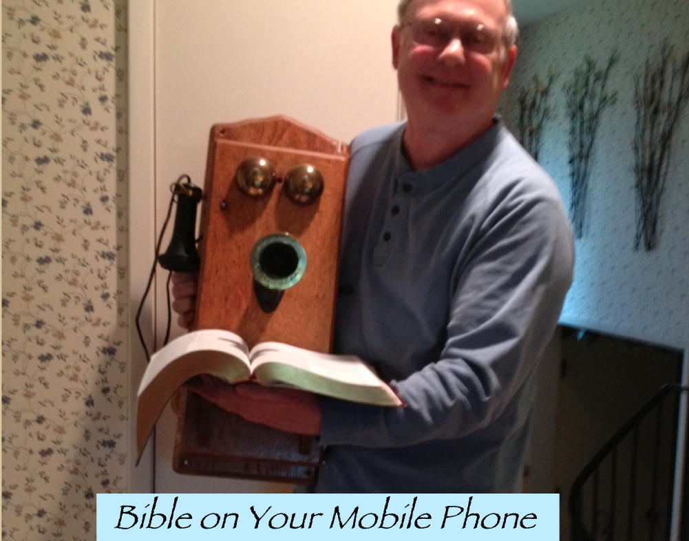 Drew Holding a Compact Bible on Your Mobile Phone